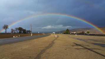 A rainbow arches over San Ardo.