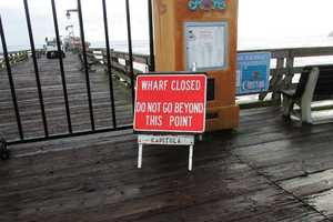 Rough surf damaged a water main at the Capitola Wharf. The wharf was closed until repairs could be completed.