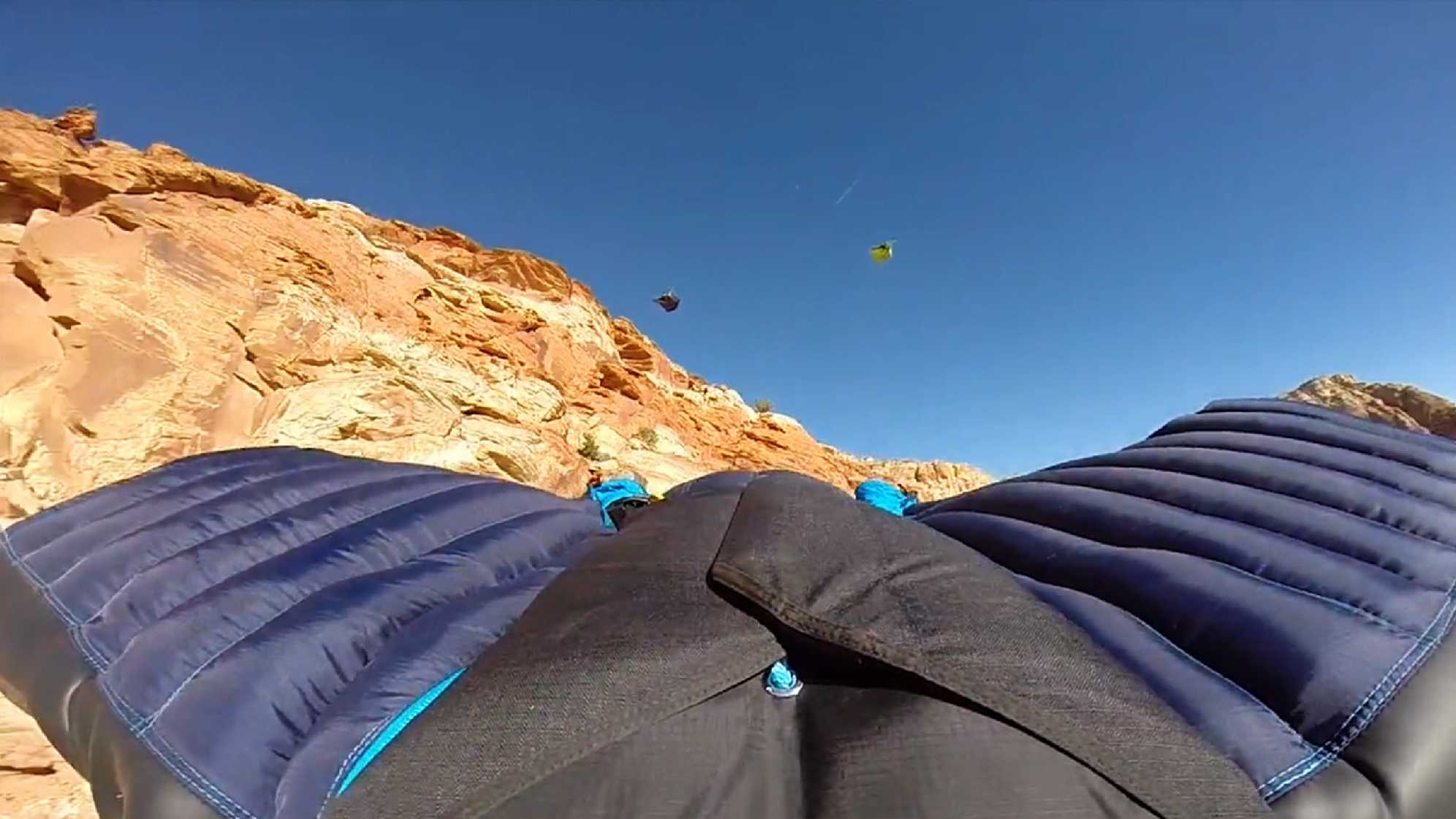 In this 2015 image, Mathew Kenney is seen among three wingsuit jumpers in Paria Canyon.