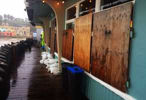Restaurants along Capitola Beach were boarded up to protect windows from battering El Nino waves.