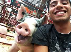 Bryce Umbarger takes a selfie with his pig at the Salinas Valley Fair.