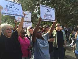 Oct. 22: Supporters raising their signs at a rally held in Palm Beach Gardens.