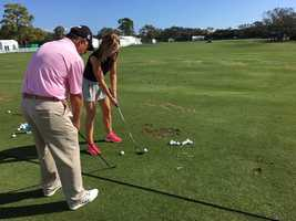 Sandra Shaw getting pro tips on the range from 2009 Allianz Champion Mike Goodes!