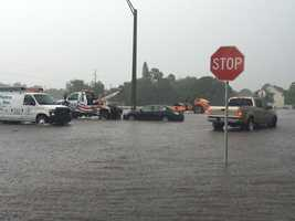 A tow truck prepares to tow three cars due to severe rainfall in Vero Beach. Photo courtesy of James Harp.