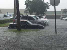 The water rose to door-level in a parking lot in Vero Beach.
