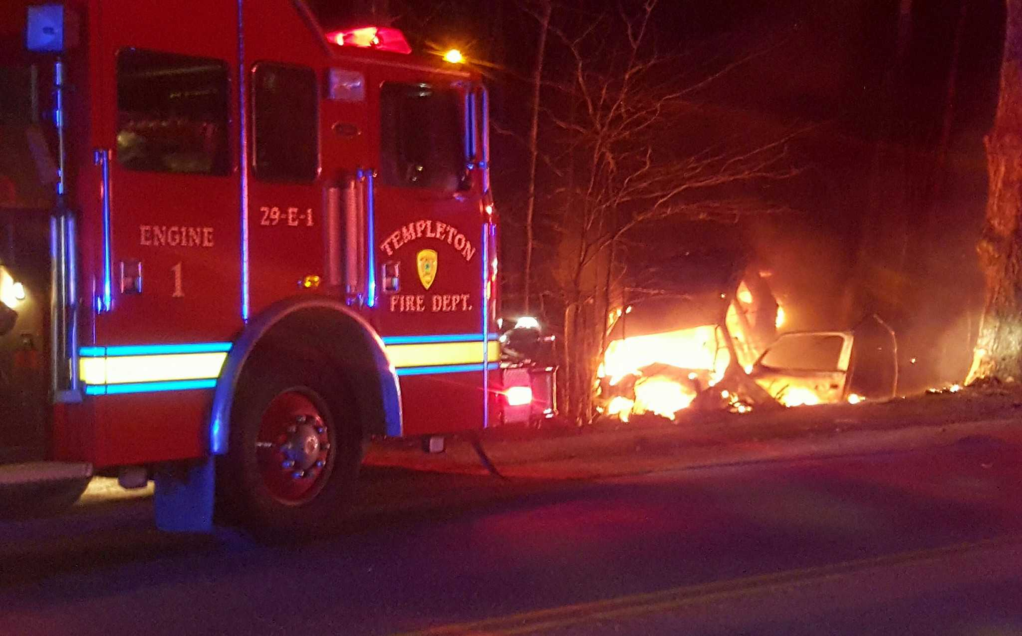 Woman saved after car hits tree, bursts into flames