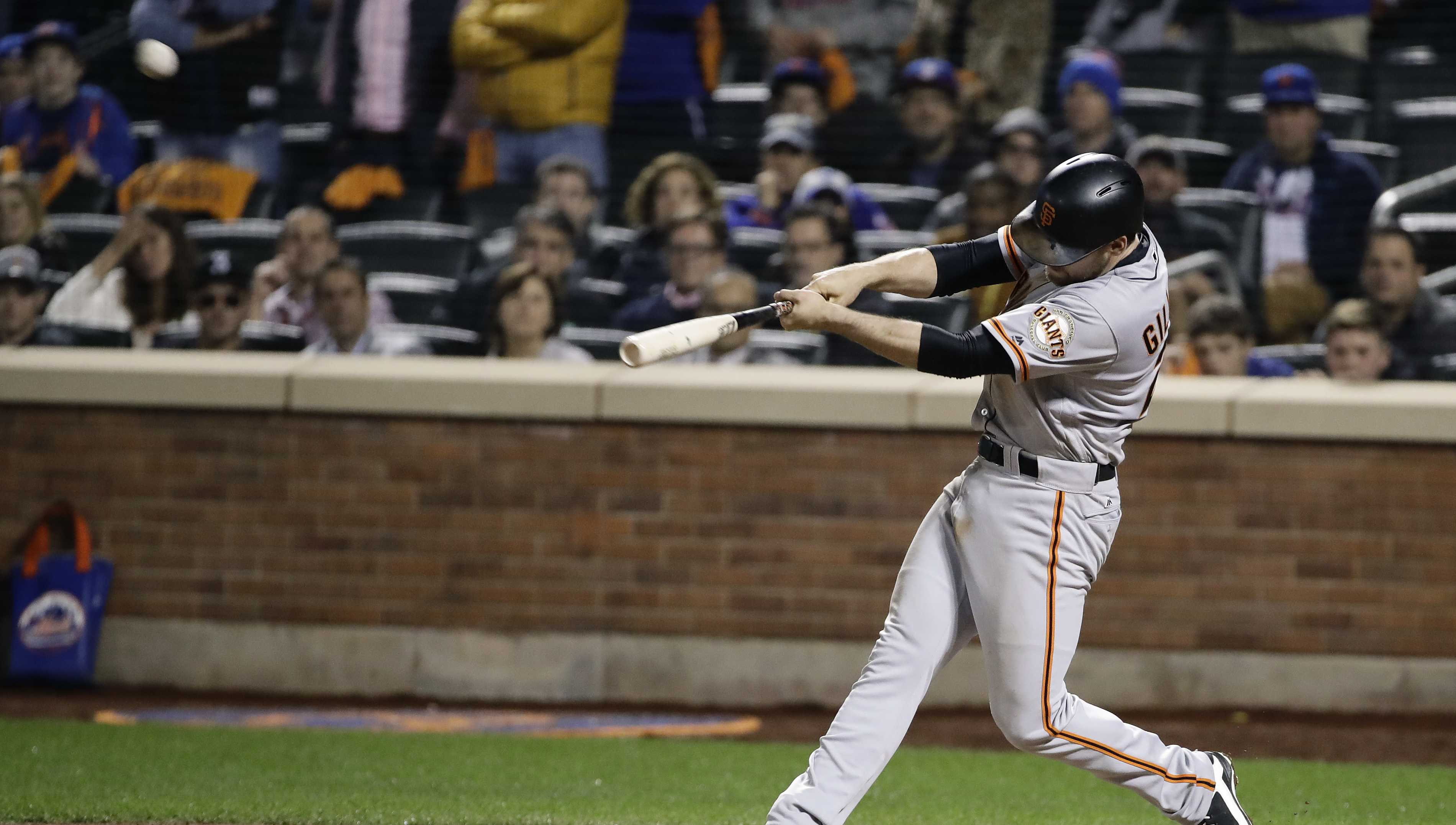 San Francisco Giants' Conor Gillaspie connects for a three-run home run against the San Francisco Giants during the ninth inning of the National League wild-card baseball game, Wednesday, Oct. 5, 2016, in New York. The Giants won 3-0.