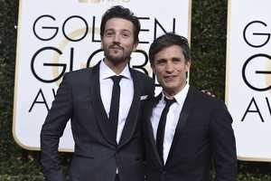 Diego Luna, left, and Gael Garcia Bernal arrive at the 74th annual Golden Globe Awards at the Beverly Hilton Hotel on Sunday, Jan. 8, 2017, in Beverly Hills, Calif. (Photo by Jordan Strauss/Invision/AP)