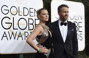 Blake Lively, left, and Ryan Reynolds arrive at the 74th annual Golden Globe Awards at the Beverly Hilton Hotel on Sunday, Jan. 8, 2017, in Beverly Hills, Calif. (Photo by Jordan Strauss/Invision/AP)