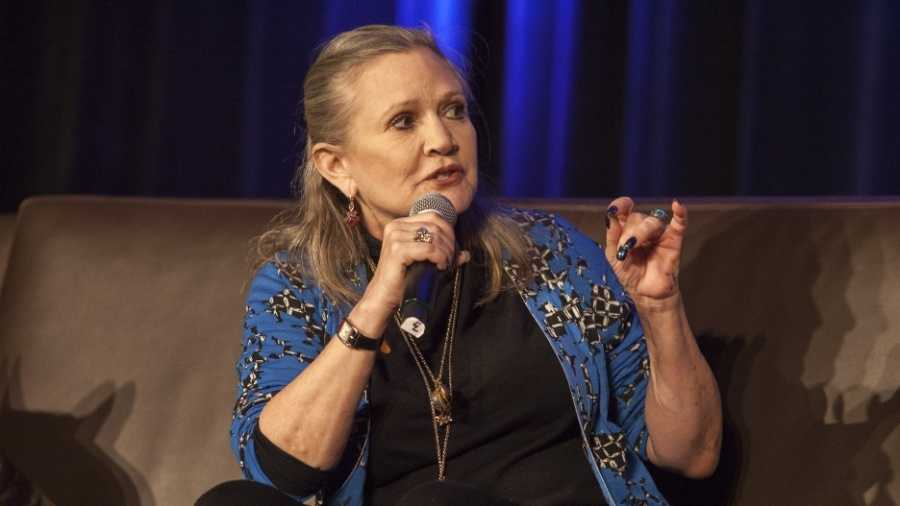 Carrie Fisher rushed off plane after heart attack
