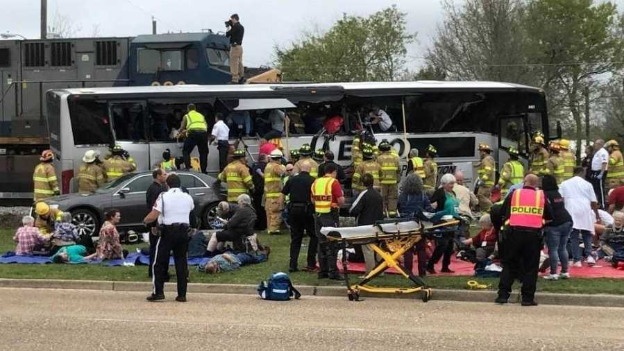 At least 3 dead after train, bus collision