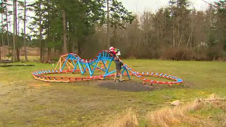 dad builds backyard roller coaster