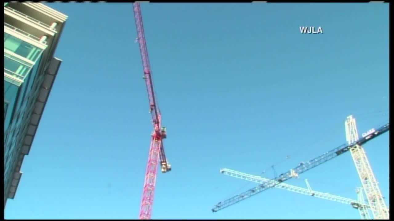 Police arrest seven protesters who climbed D.C. crane