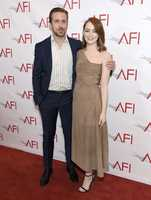 "Ryan Gosling, left, and Emma Stone, from ""La La Land,"" arrive at the AFI Awards at the Four Seasons Hotel on Friday, Jan. 6, 2017, in Los Angeles."