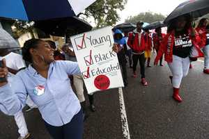 Mariah Hickman, a Dillard University student march in unison with fellow students, to a polling place to vote on election day in New Orleans.