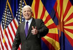 Sen. John McCain, R-Ariz., smiles as he waves to supporters at his victory party prior to announcing his victory over Democratic Rep. Ann Kirkpatrick .