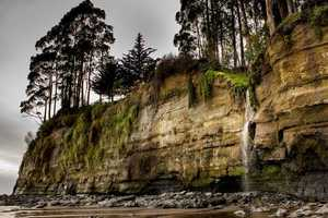 A waterfall forms at New Brighton Beach in Capitola.