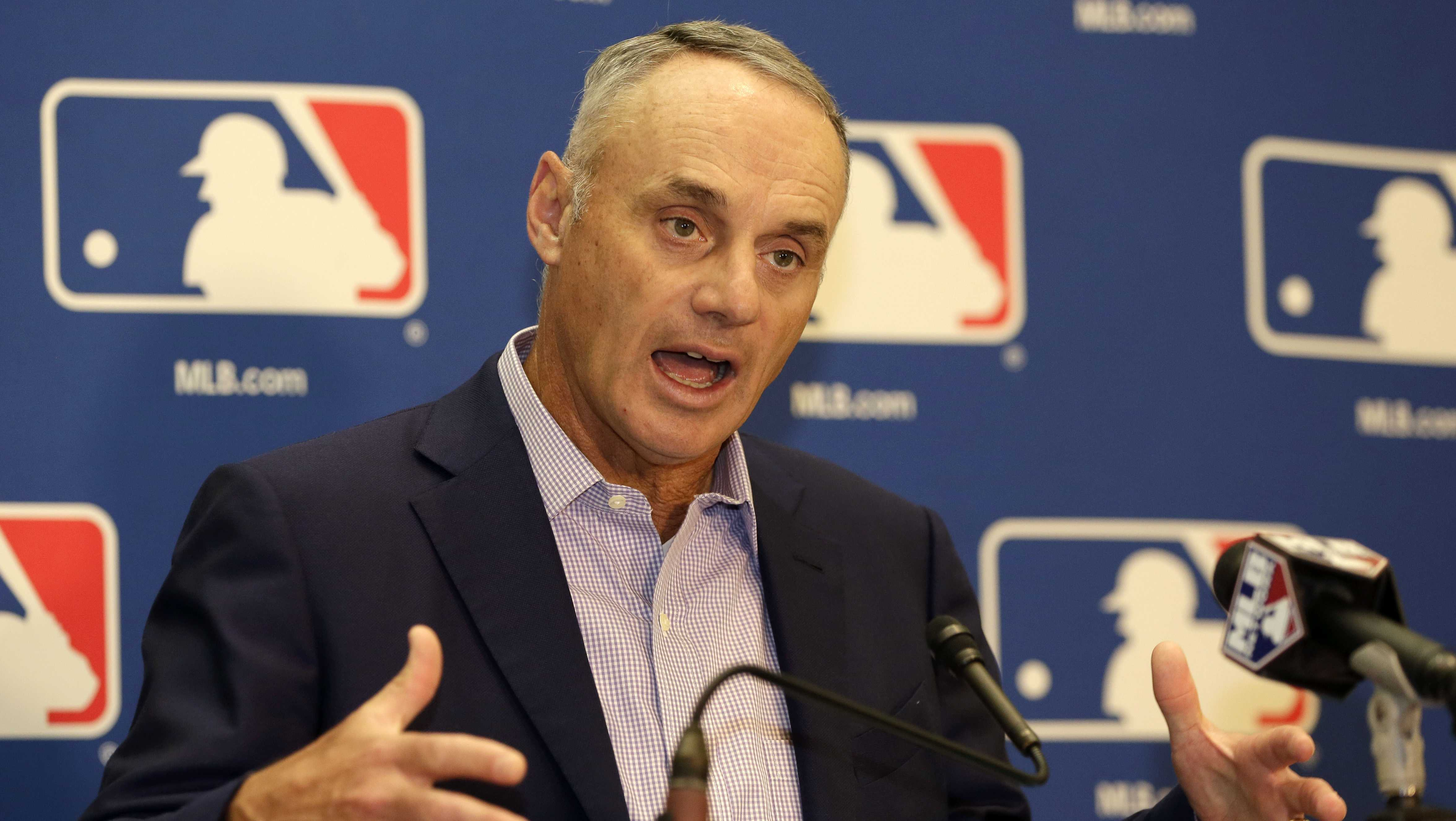 Major League Baseball Commissioner Rob Manfred speaks during a news conference following a meeting with MLB owners, Friday, Feb. 3, 2017, in Palm Beach, Fla.