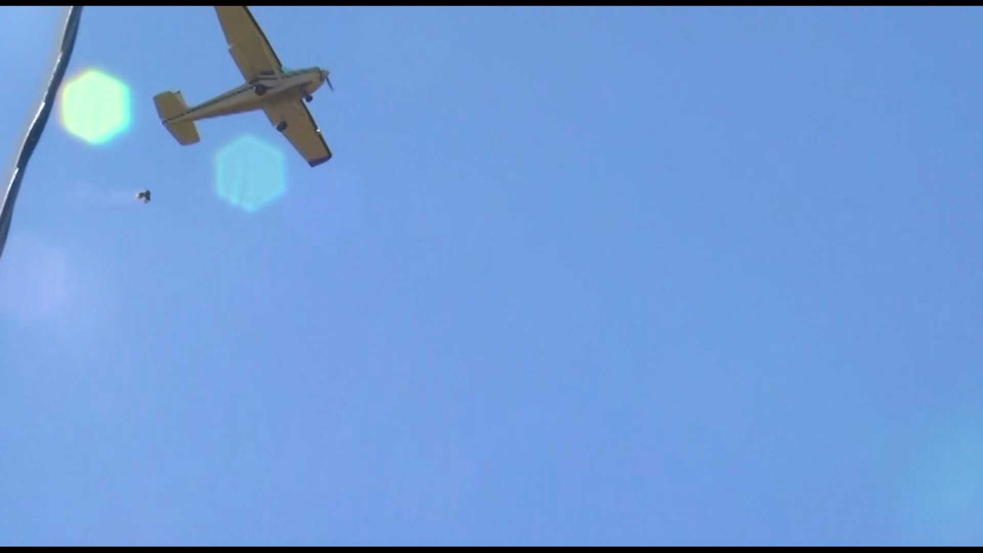 A plane drops a turkey over Yellville, Ark. on Saturday
