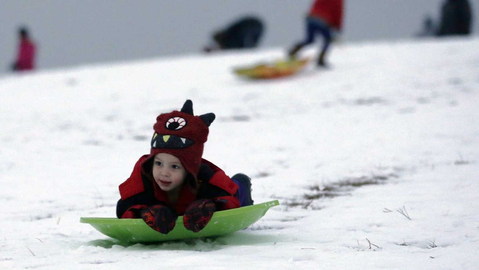 Clild sledding in snow.jpg