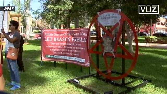community protests satanic symbol in public park