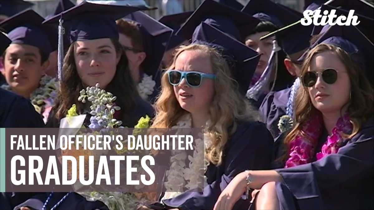 Police officers present high school diploma to daughter of fallen officer