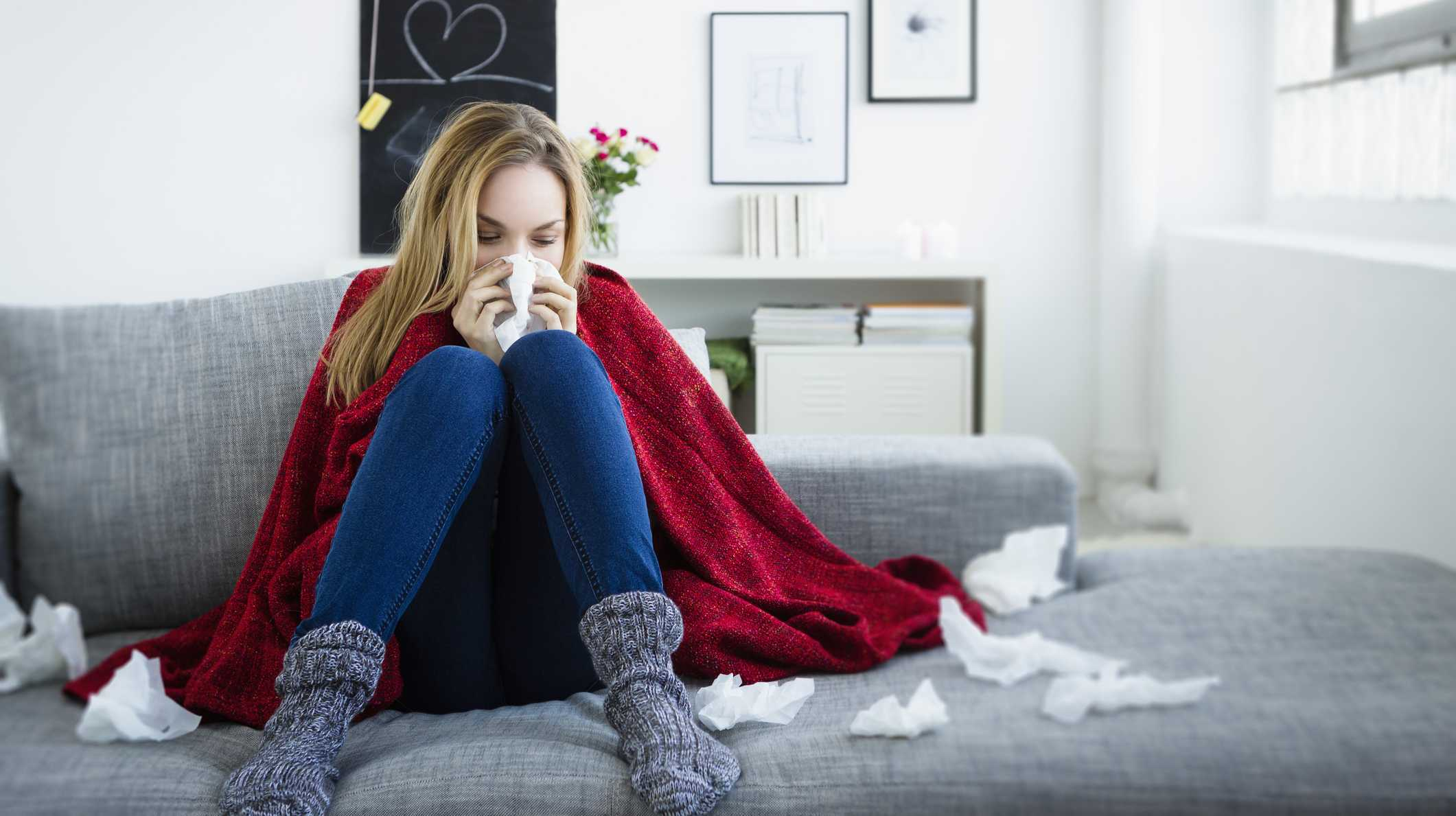 Woman with tissues suffering from the flu