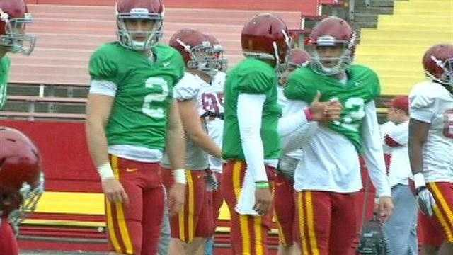 ISU defense shines, QBs battle