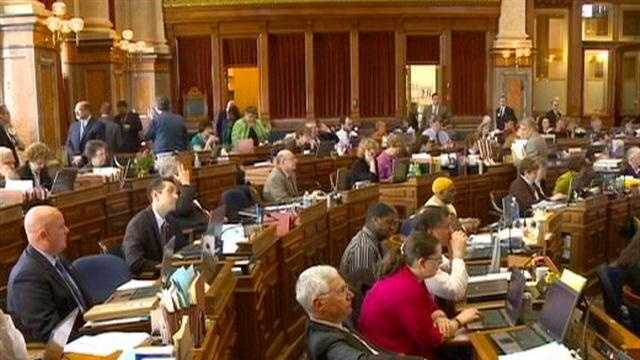 Iowa lawmakers are still at the Statehouse 10 days after they were supposed to have adjourned.
