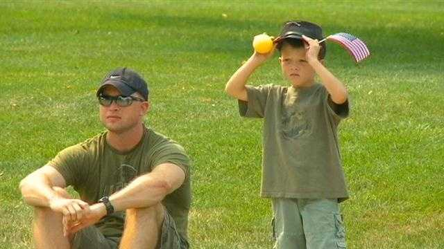 Parade image - boy and dad with flag