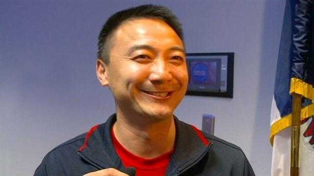 Iowa Olympics coach Liang Chow returned home to Des Moines Wednesday afternoon.