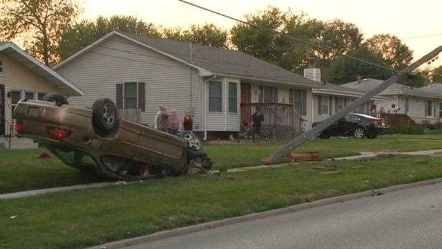 Driver clips car and power pole before flipping