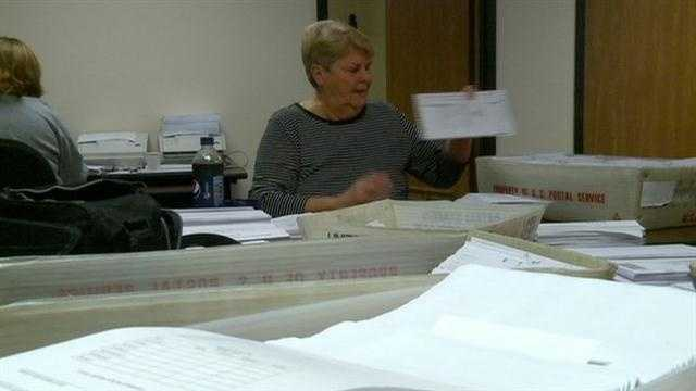 KCCIs Laura Nichols checks on early voting ballot numbers.