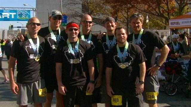 Seven Iowans run the Des Moines Marathon to benefit a wounded soldier named Taylor Morris.