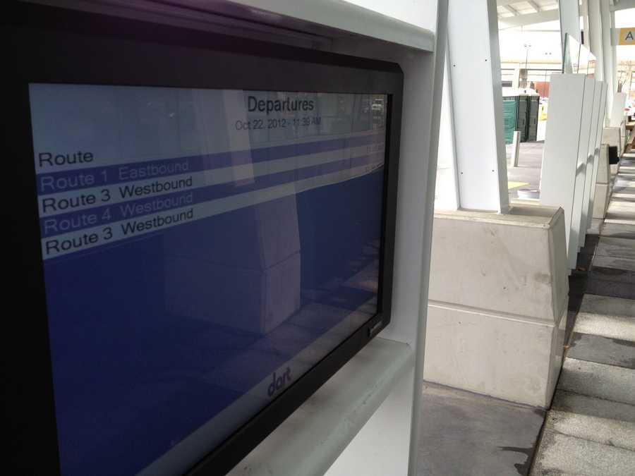Monitors update passengers on which platform their bus will be arriving and when it will arrive.