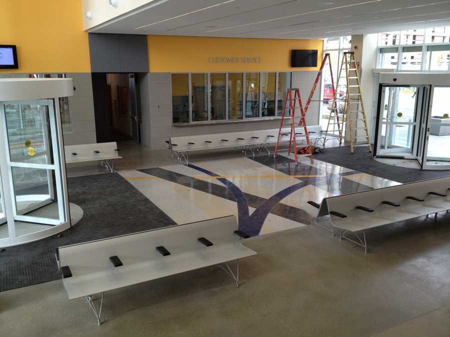 Main waiting area features seating for 75 customers, customer service windows, public art in the floor and restrooms in a climate controlled setting.