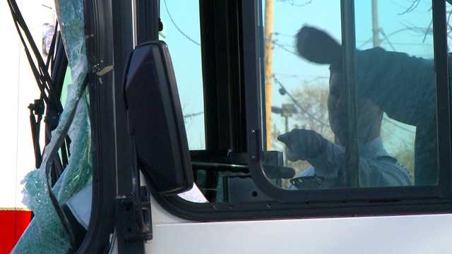 A DART bus windshield shatters during crash.
