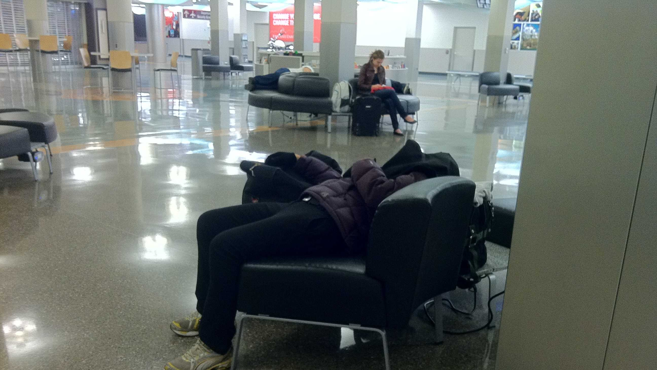 Passengers snuggle in for the night at the Des Moines airport.