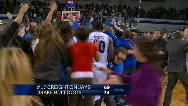 Drake University fans stormed the court after the men's basketball team upset 17th ranked Creighton.