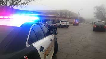 Police search school after receiving email threat.