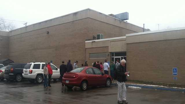 Parents wait to collect their children at YMCA.