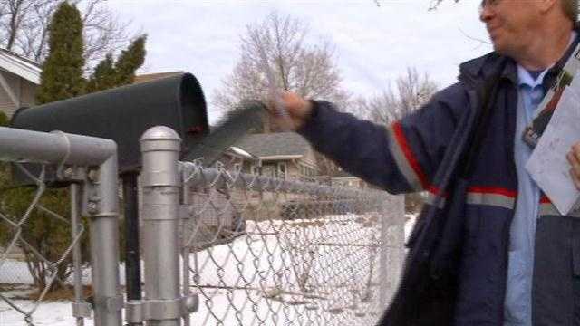 Postal worker delivers mail