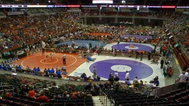 Iowa wrestling fans at the state tournament react to the Olympics dropping wrestling.