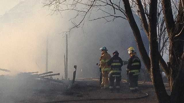 Firefighters fight farm building fire near Kelley.