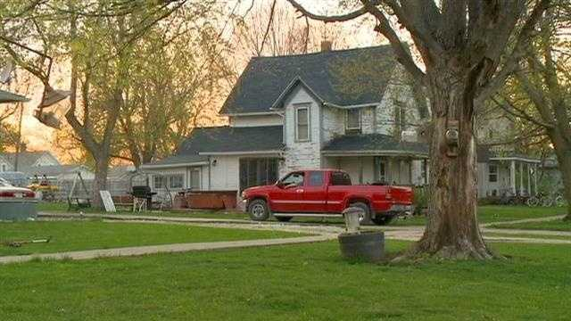 A Madison County man is in custody after he threatened to burn down his home, police said.