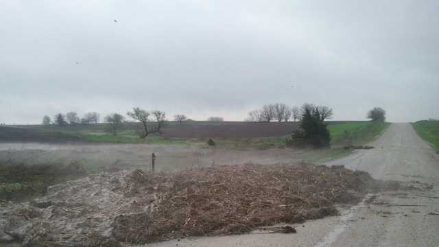 Hail and cornstalks washed onto road southwest of Afton in Union County.