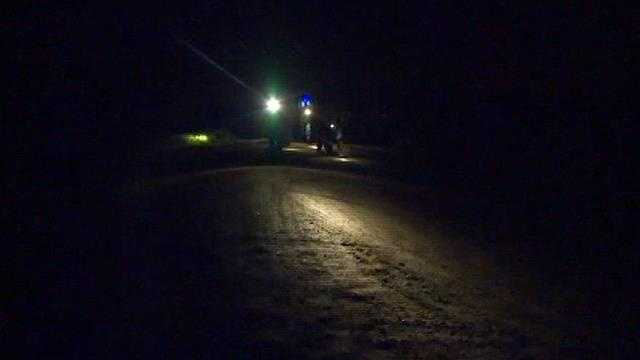 Searchers use headlights and flashlights to search late Monday night.