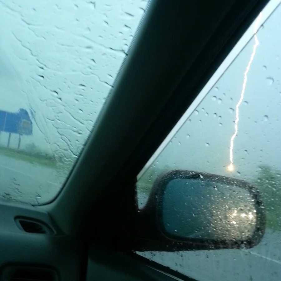 Lightning strike captured out car window.