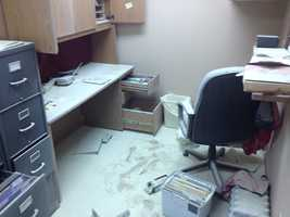 This office is covered in dust, drawers and cabinets pulled open.
