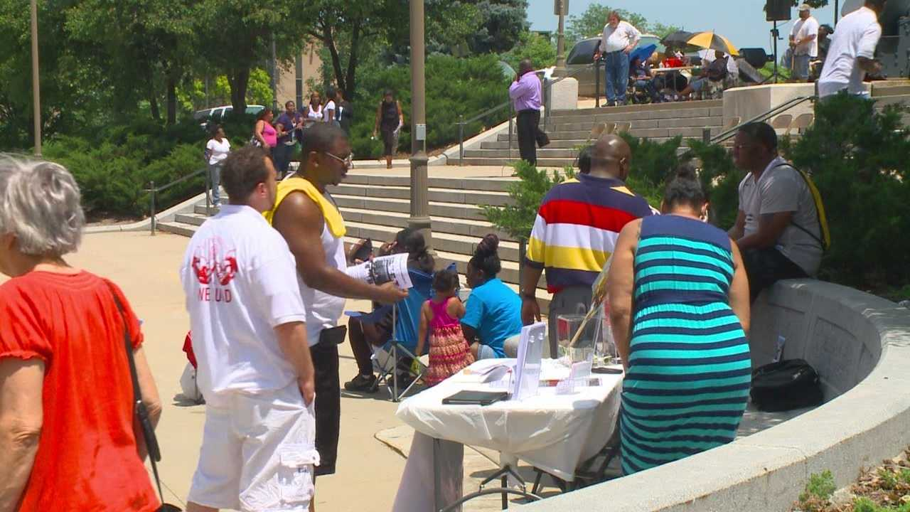 Residents rally Saturday to put a stop to gun violence on the streets of Des Moines.